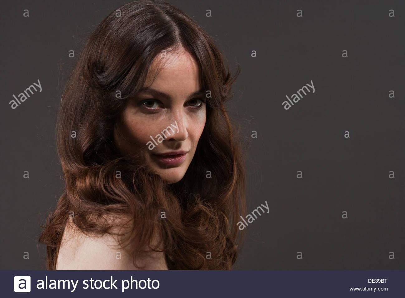 Pensive, torse nu femme Photo Stock