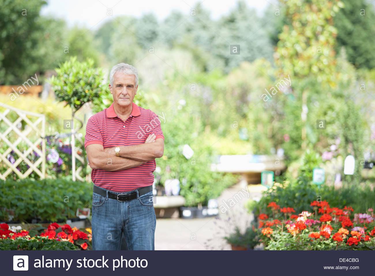 Man Standing in garden Photo Stock
