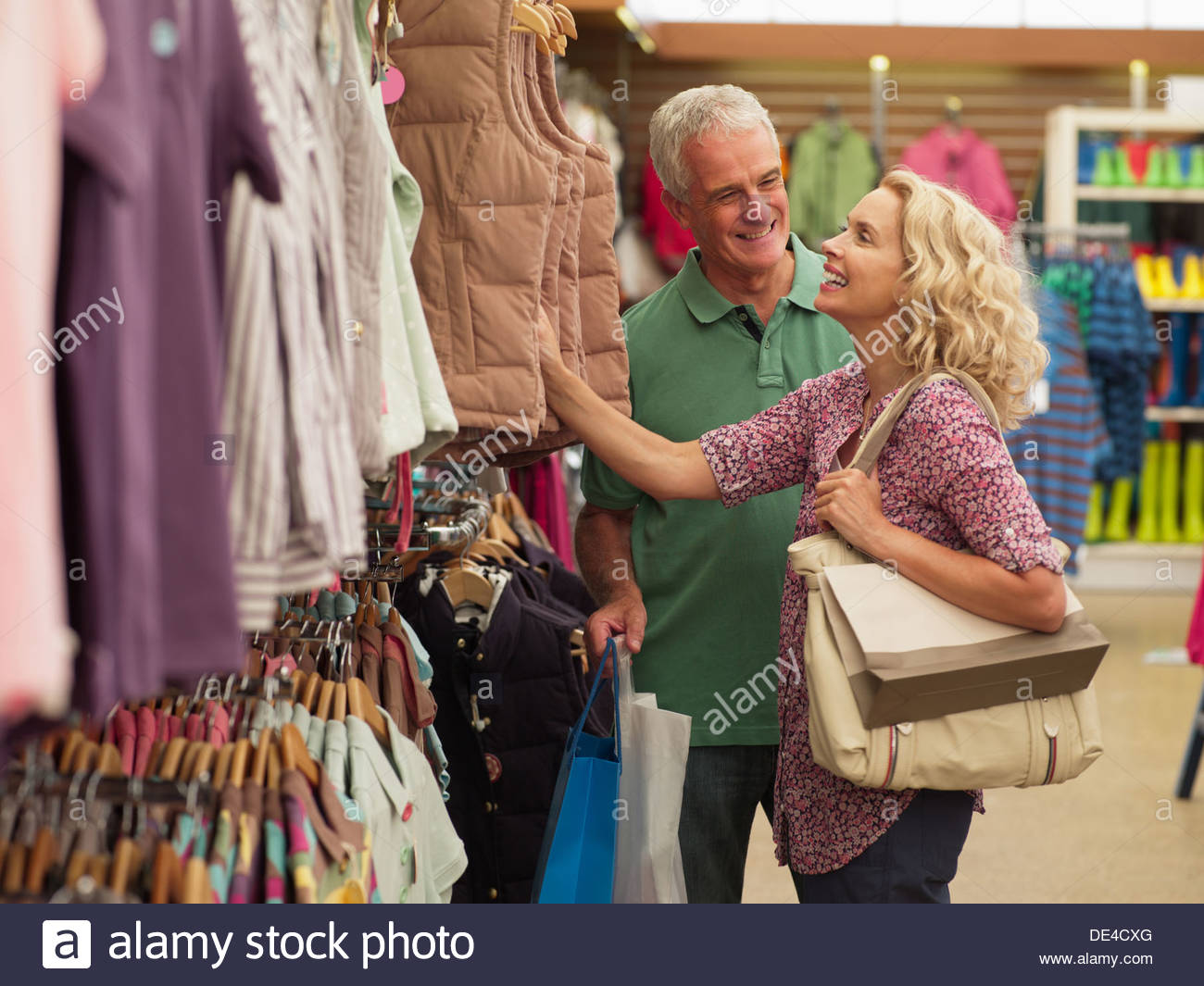 Couple shopping for clothing in store Photo Stock