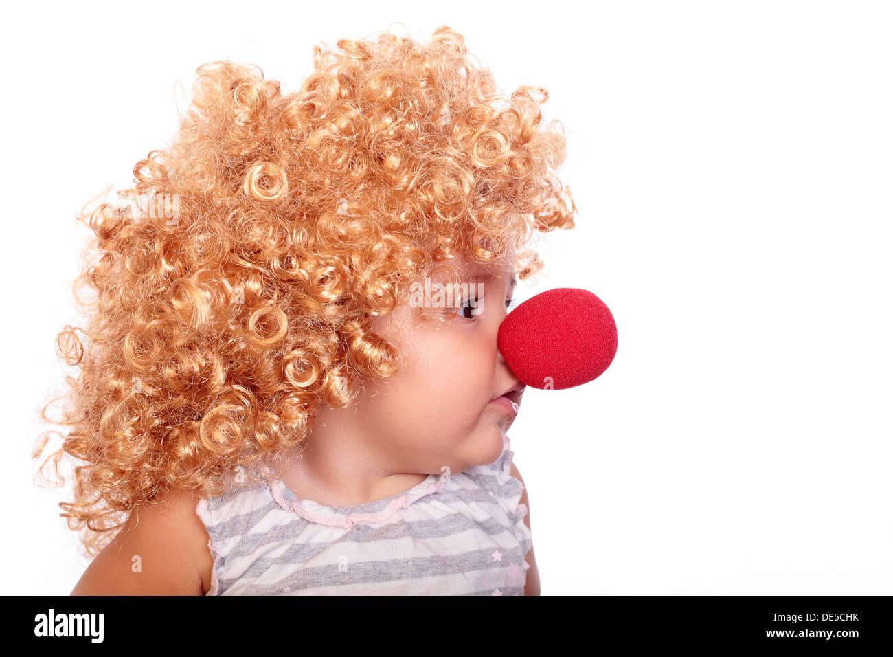 Petit bébé clown avec un nez rouge Photo Stock