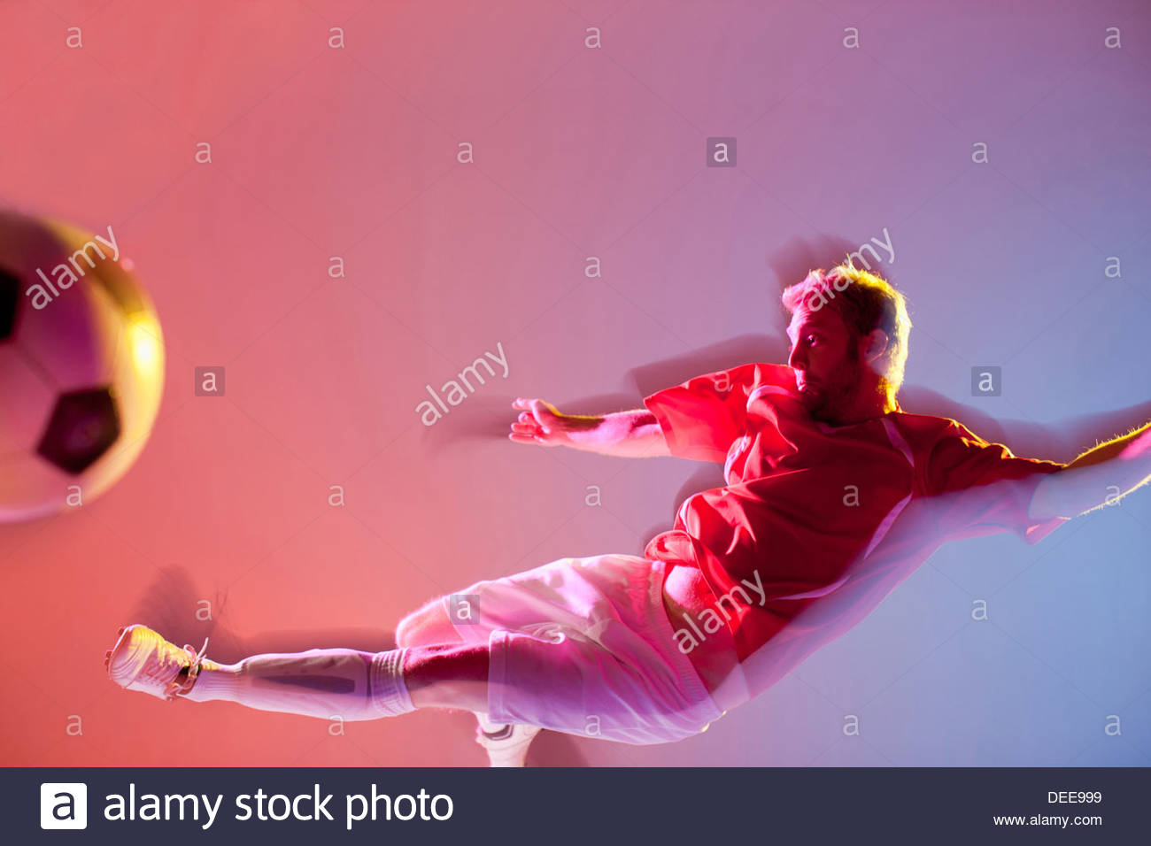 Blurred view of soccer player kicking ball Photo Stock
