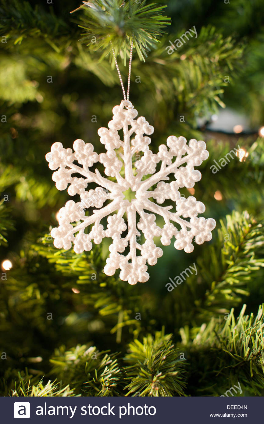 Snowflake Christmas ornament on tree Photo Stock