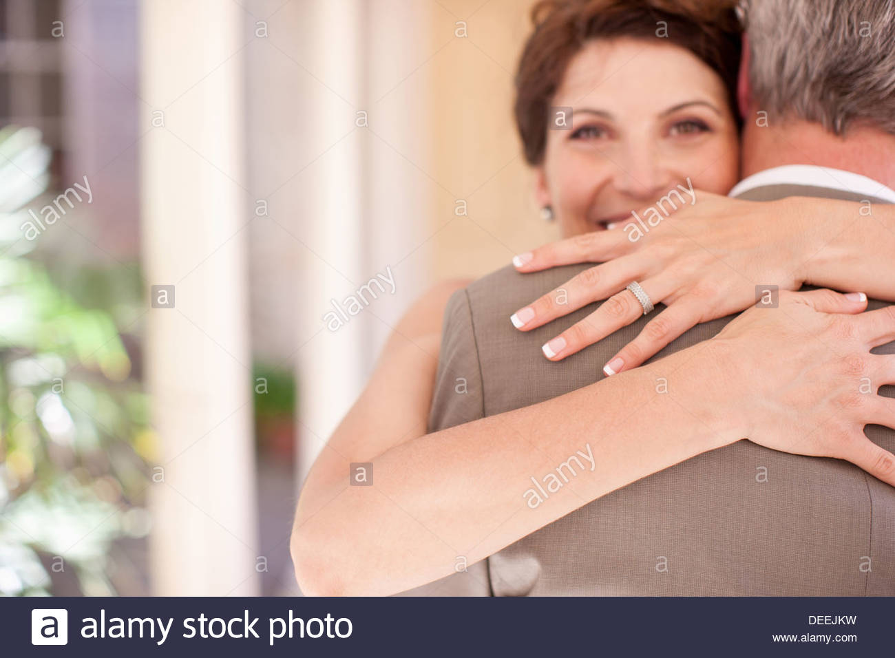 Mature Bride and Groom hugging Photo Stock