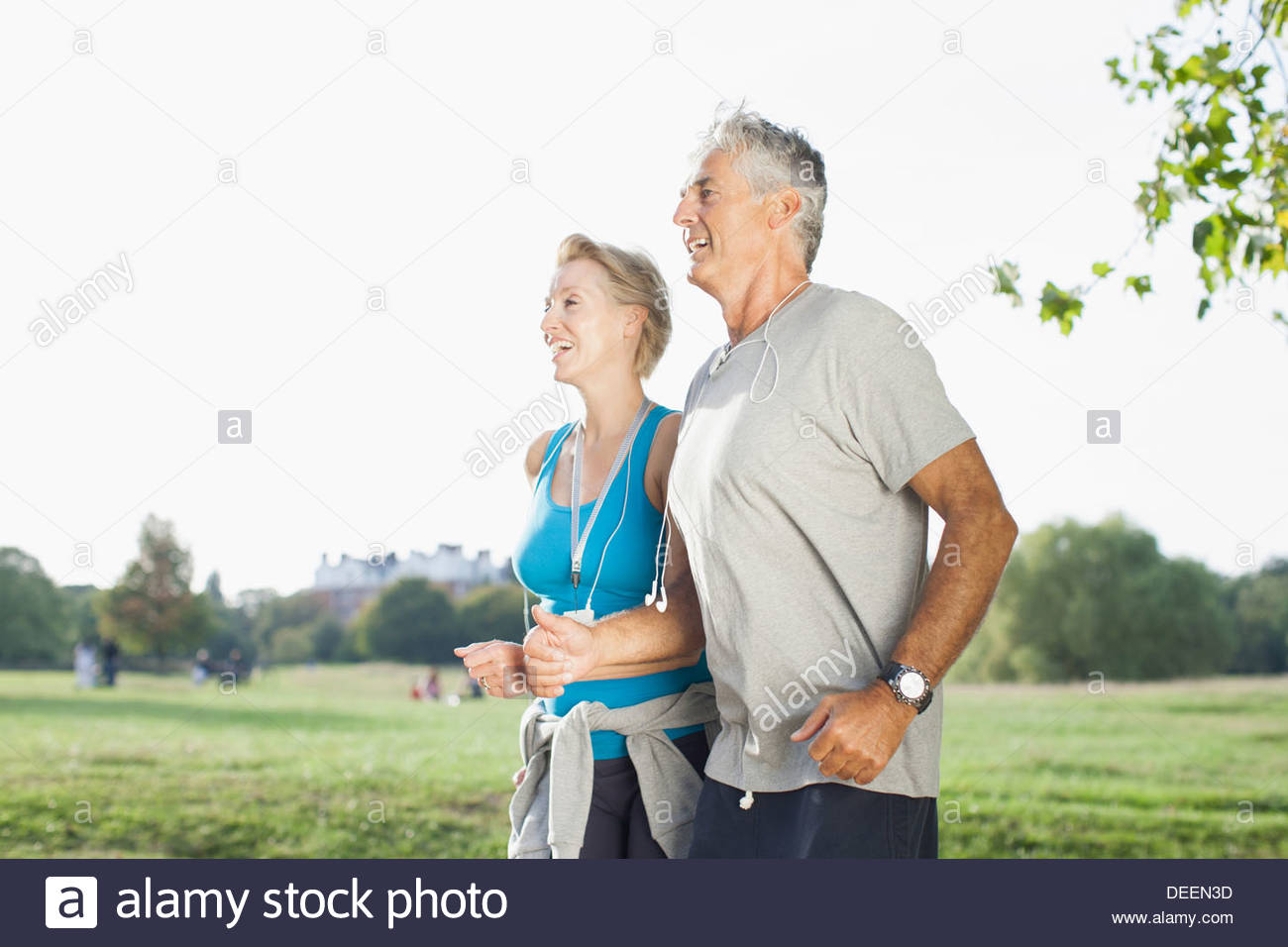 Couple jogging together outdoors Photo Stock