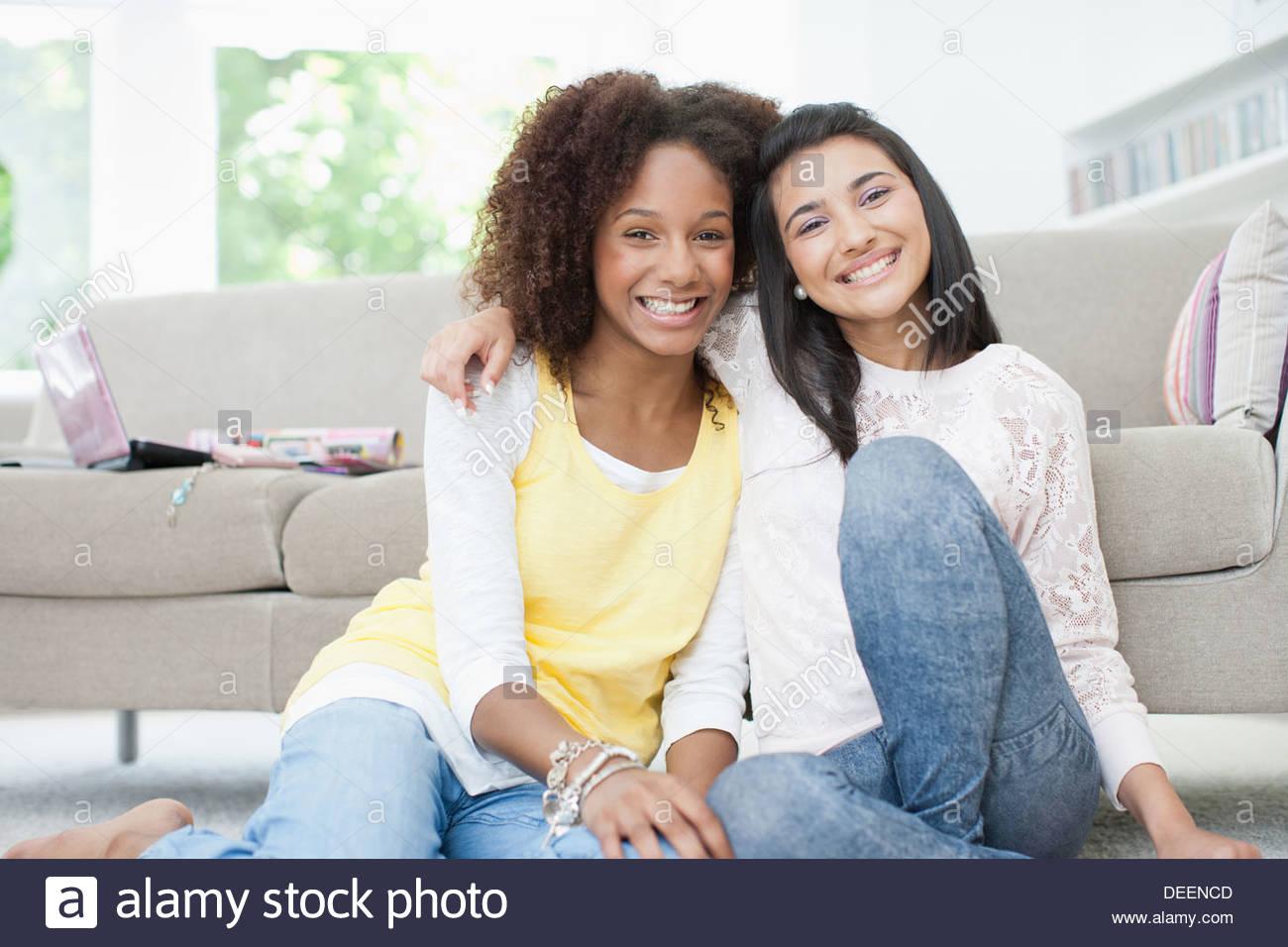 Smiling teenage girls hugging Photo Stock