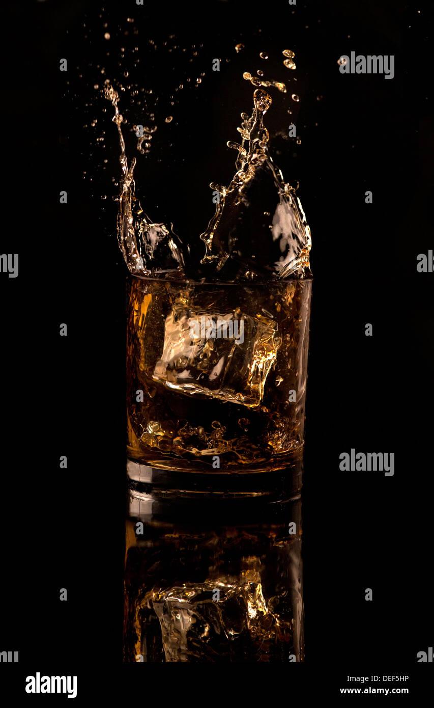 Éclaboussure de whisky Photo Stock