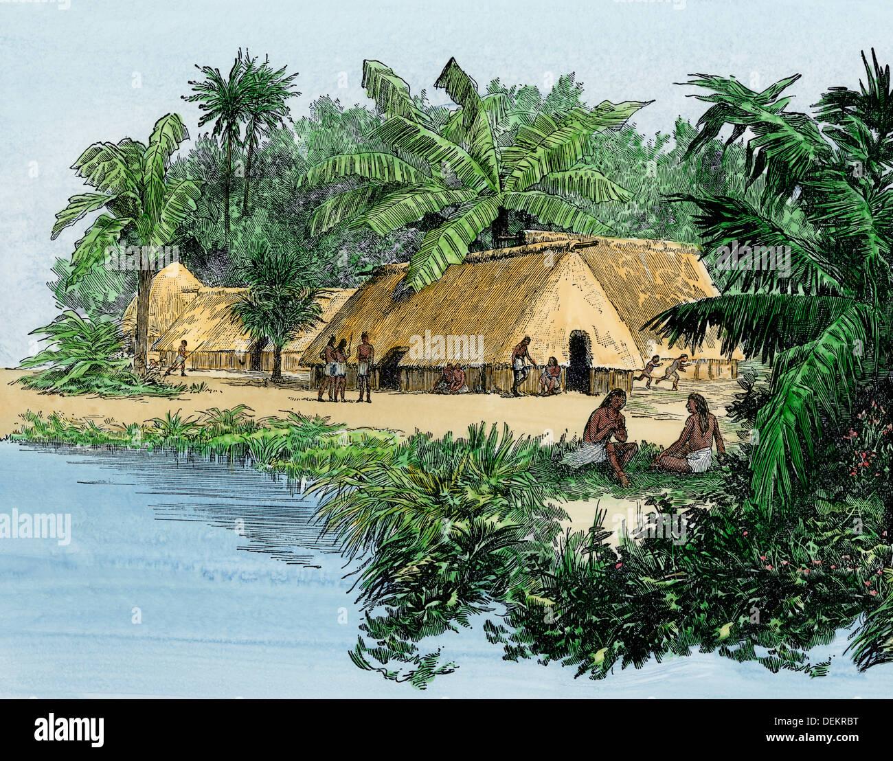 Village natal au Panama au moment de l'expédition de Balboa, début des années 1500. À la main, gravure sur bois Photo Stock