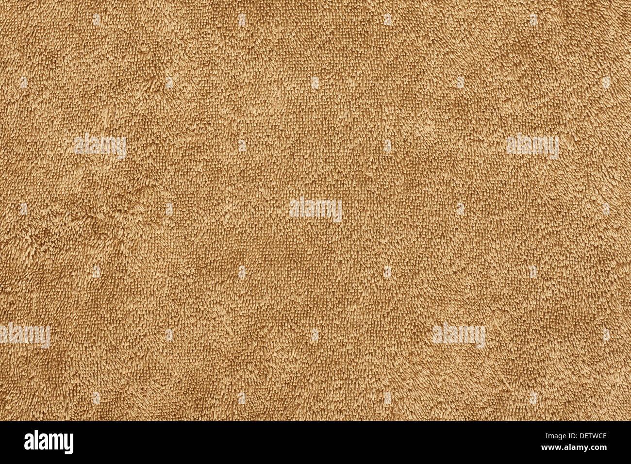 Arrière-plan de l'éponge coton twist sur une serviette de plage beige Photo Stock