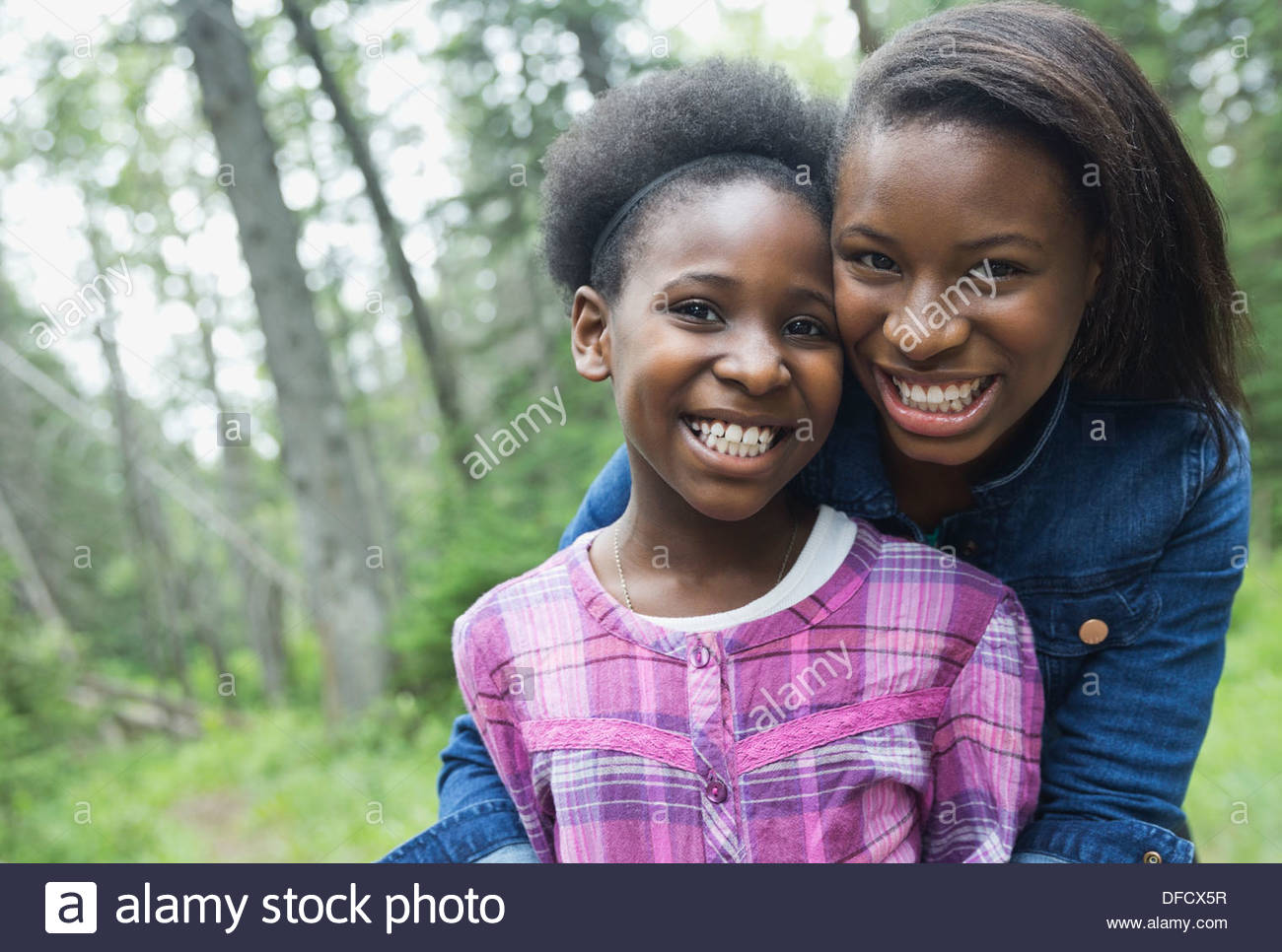 Portrait of sisters Standing together in forest Photo Stock
