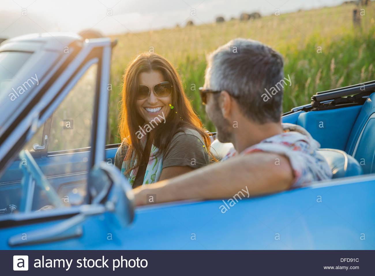 Happy couple on road trip in convertible Photo Stock