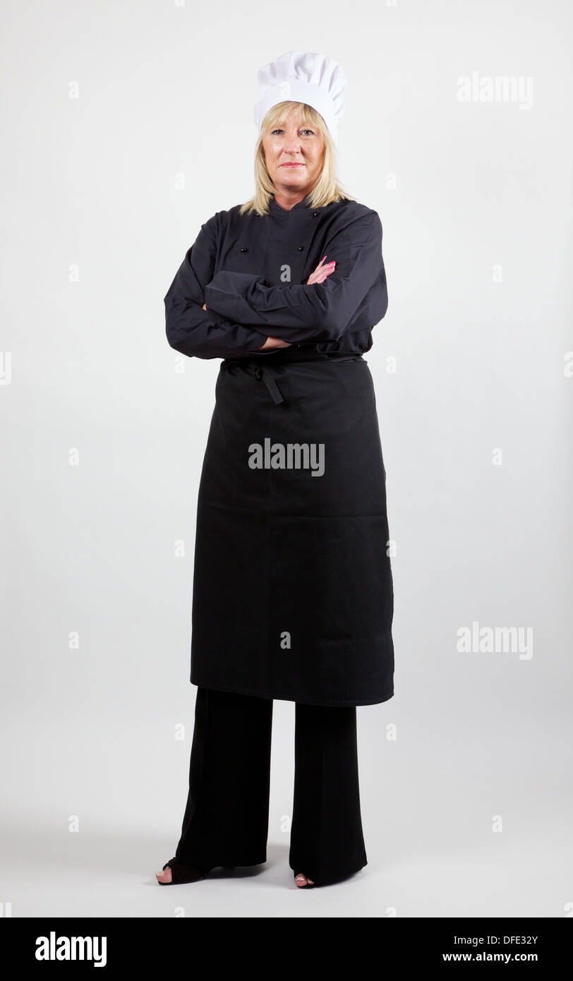 Femme chef against white background Photo Stock