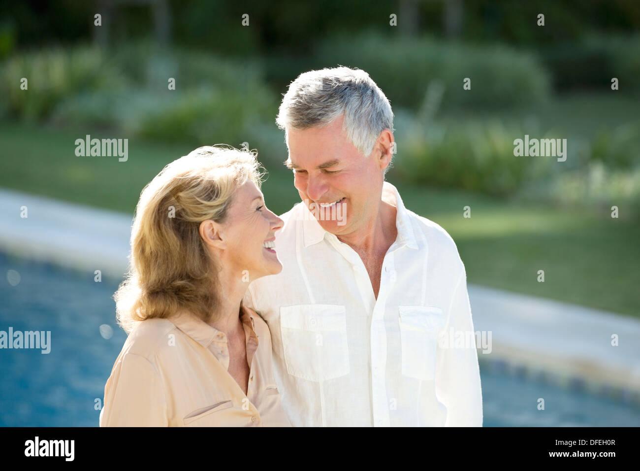 Senior couple at poolside Photo Stock