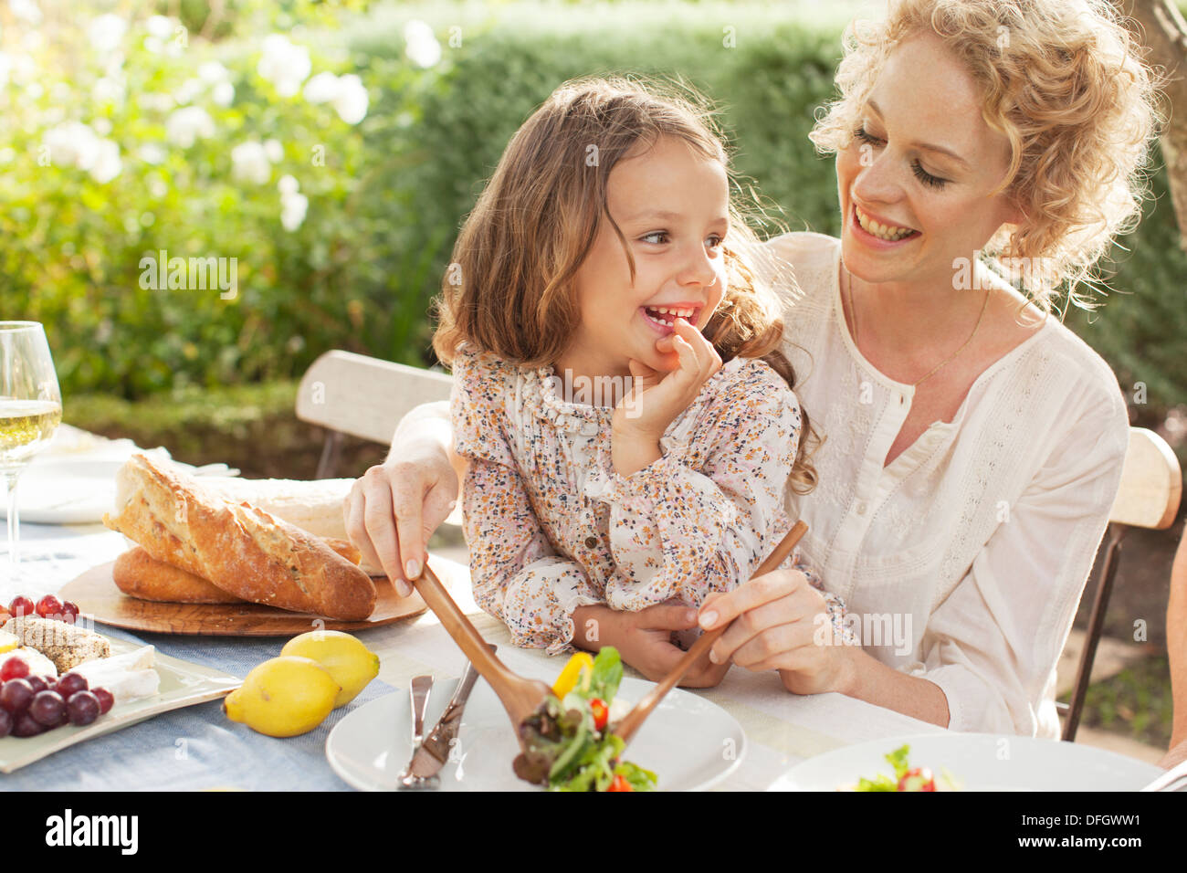 Mother and Daughter eating in garden Photo Stock