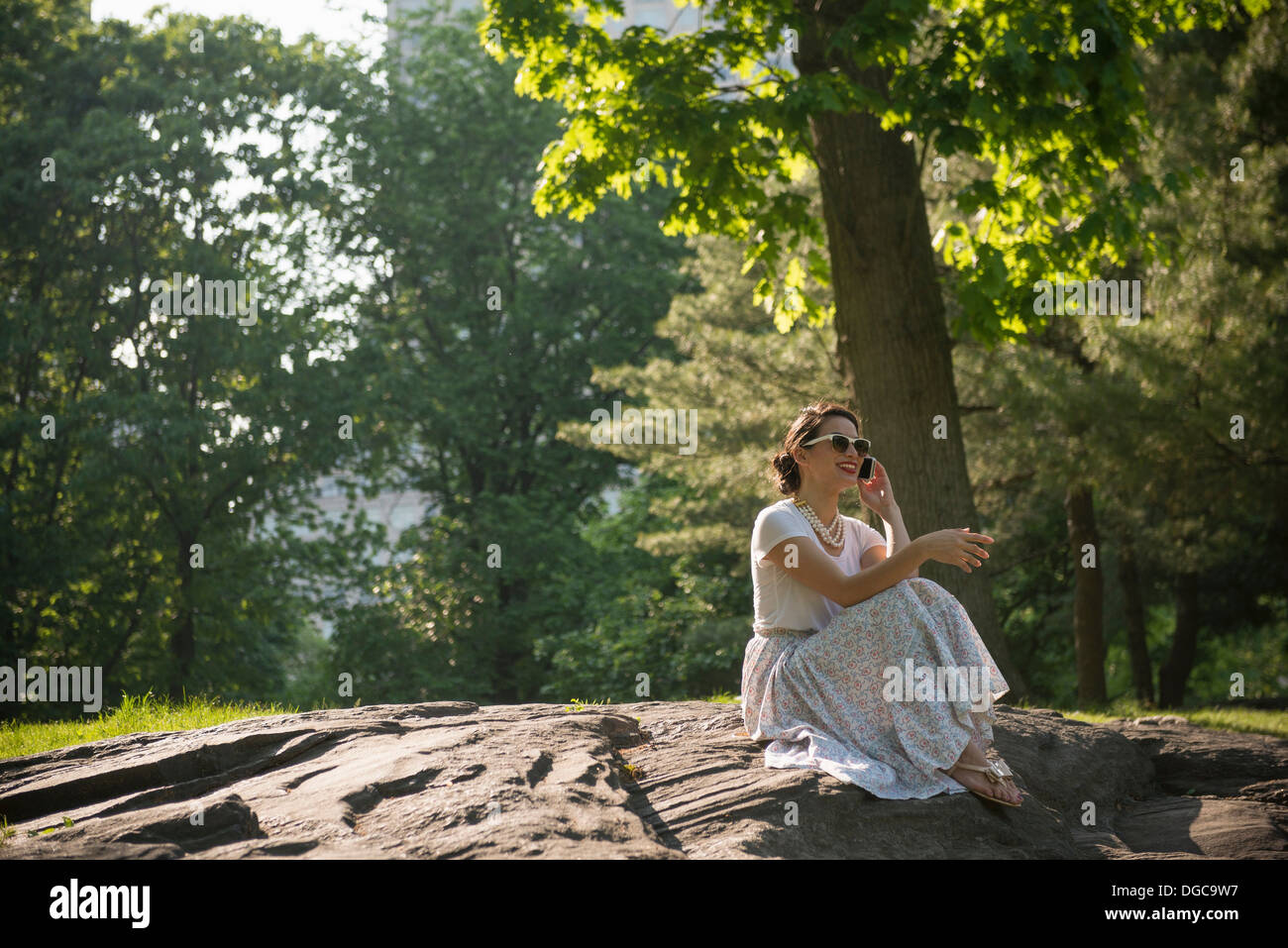 Mid adult women using mobile phone in Central Park, New York Photo Stock