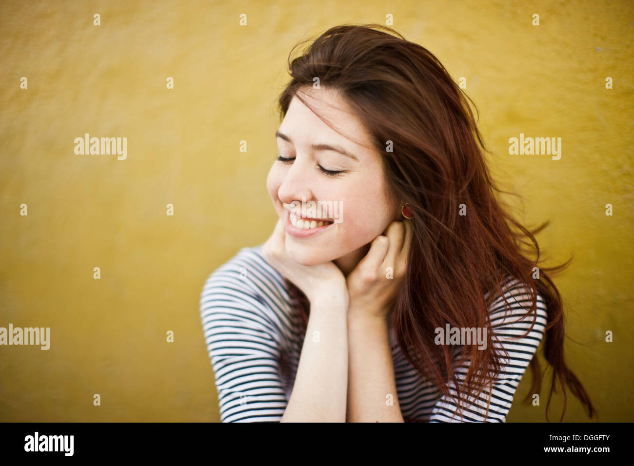 Candid portrait of young woman with eyes closed Photo Stock
