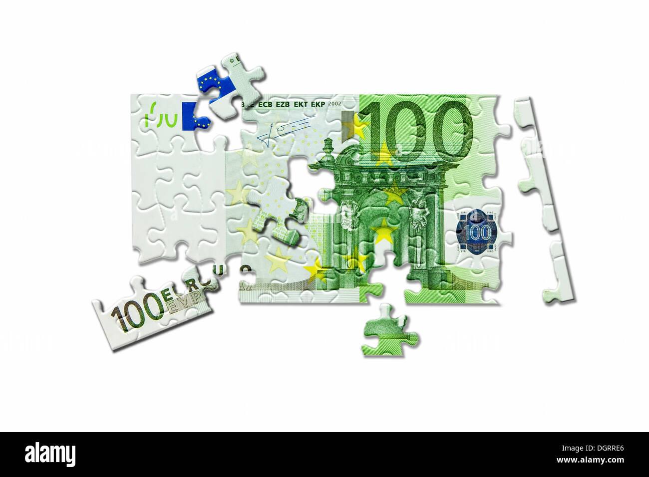 100-billet d'Euro dissolvant, puzzle, désintégration de l'euro, l'image symbolique Photo Stock