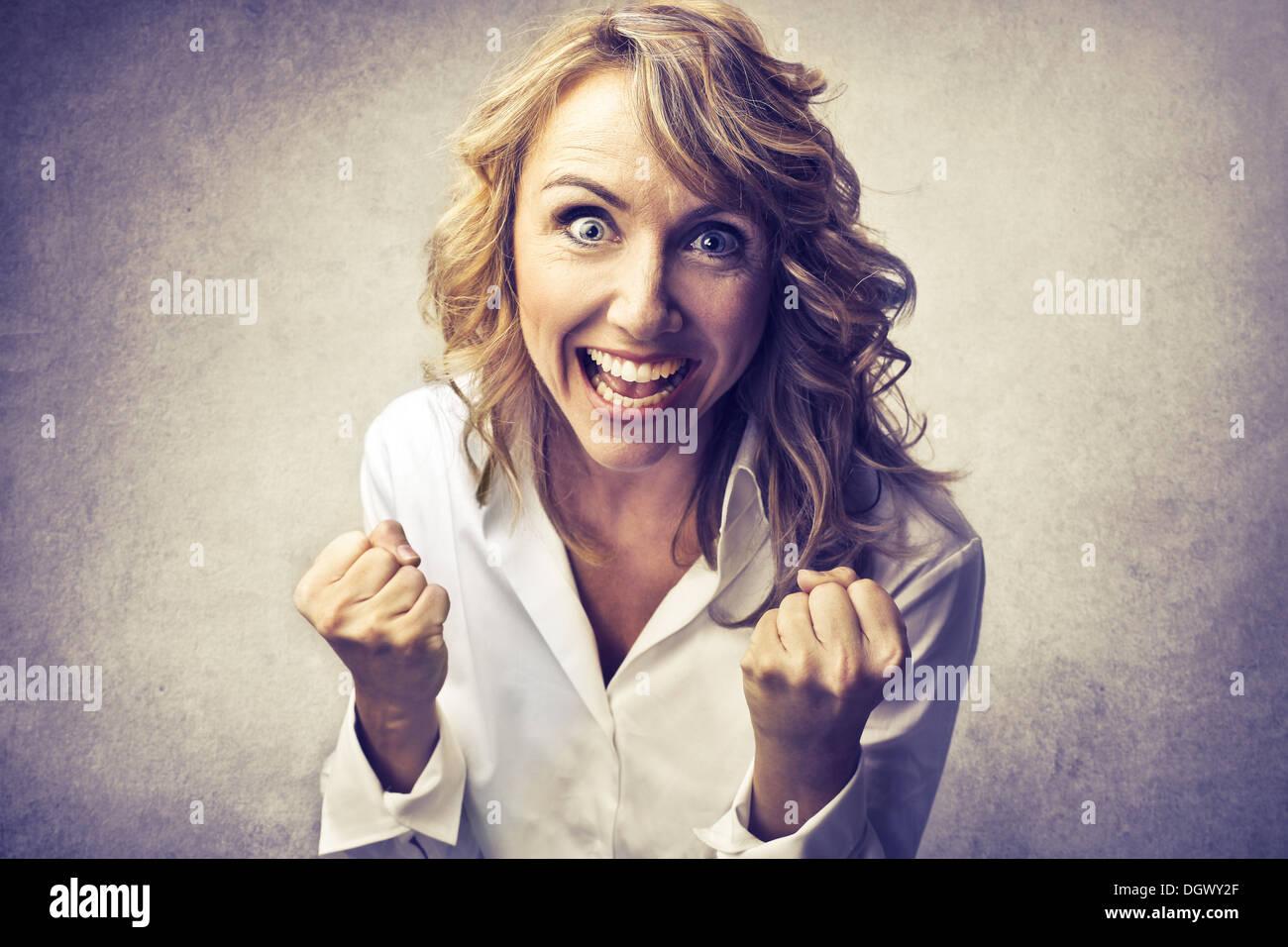Femme blonde réjouissance Photo Stock