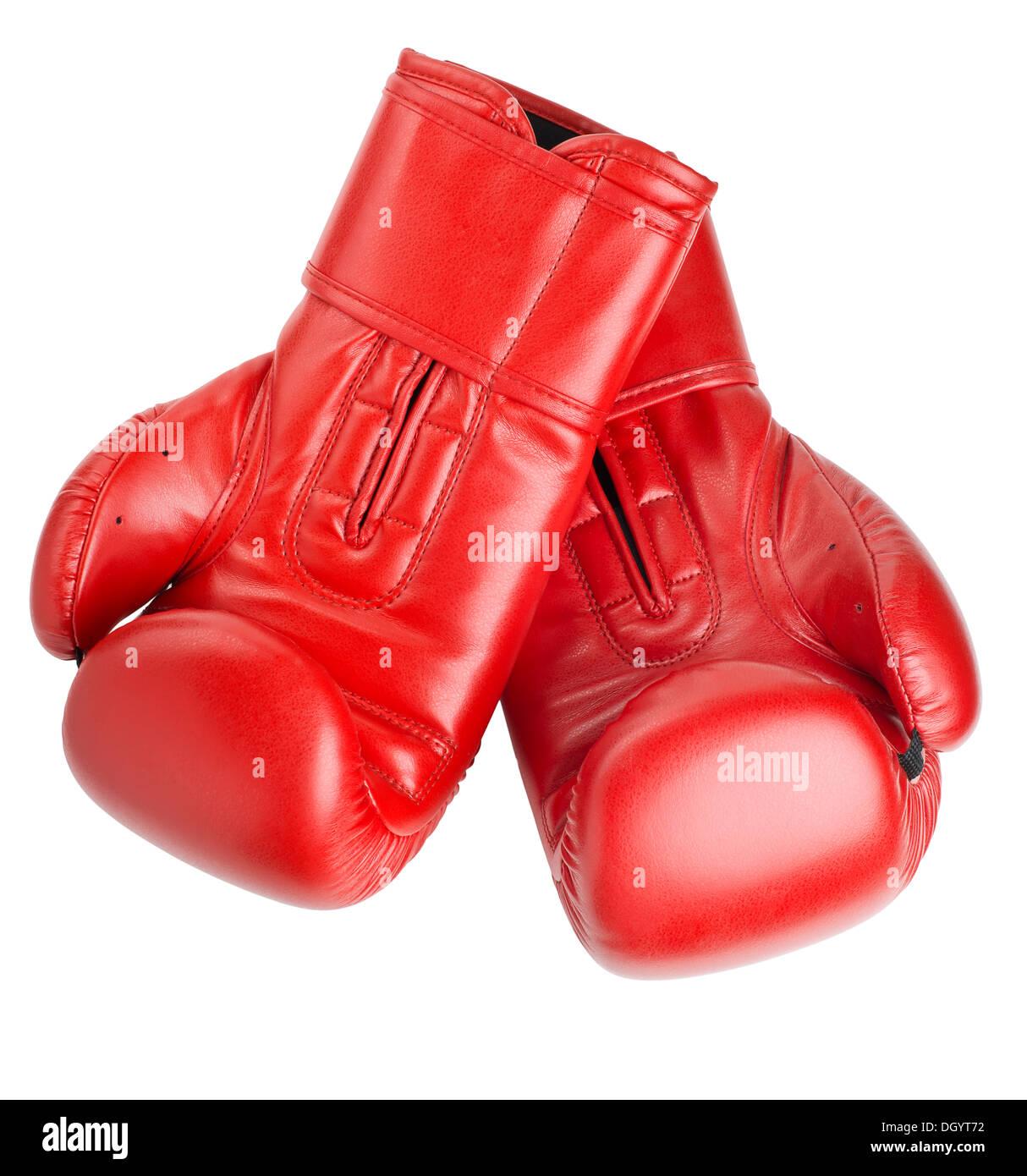 Gants de boxe en cuir rouge isolé sur fond blanc Photo Stock