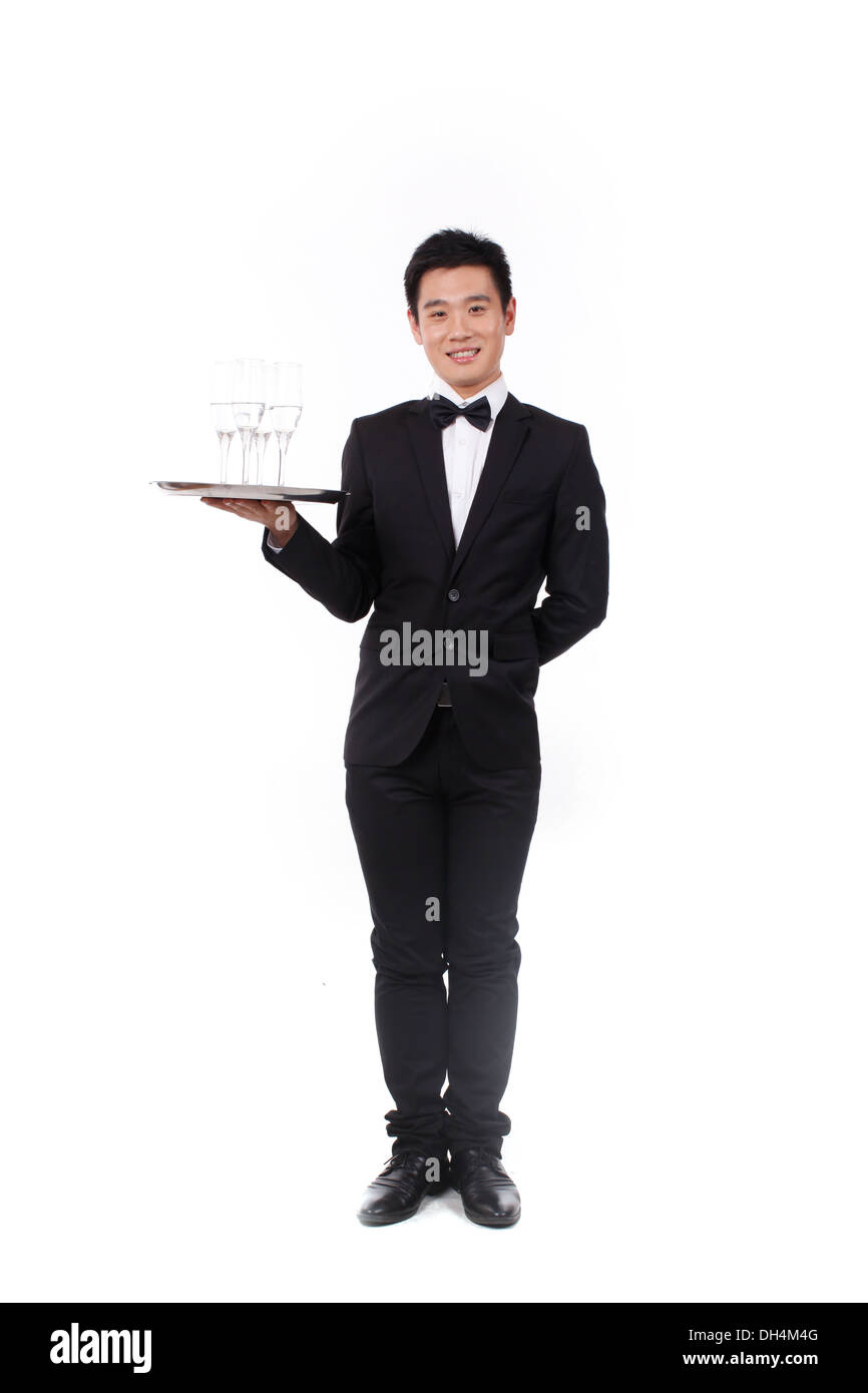 Man in tuxedo holding a plate Banque D'Images