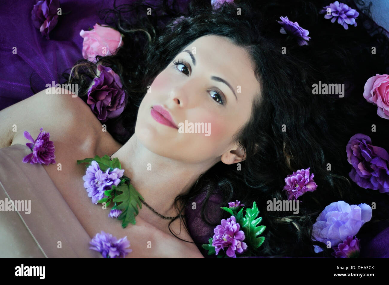 Portrait of a young Beautiful woman lying on bed Photo Stock