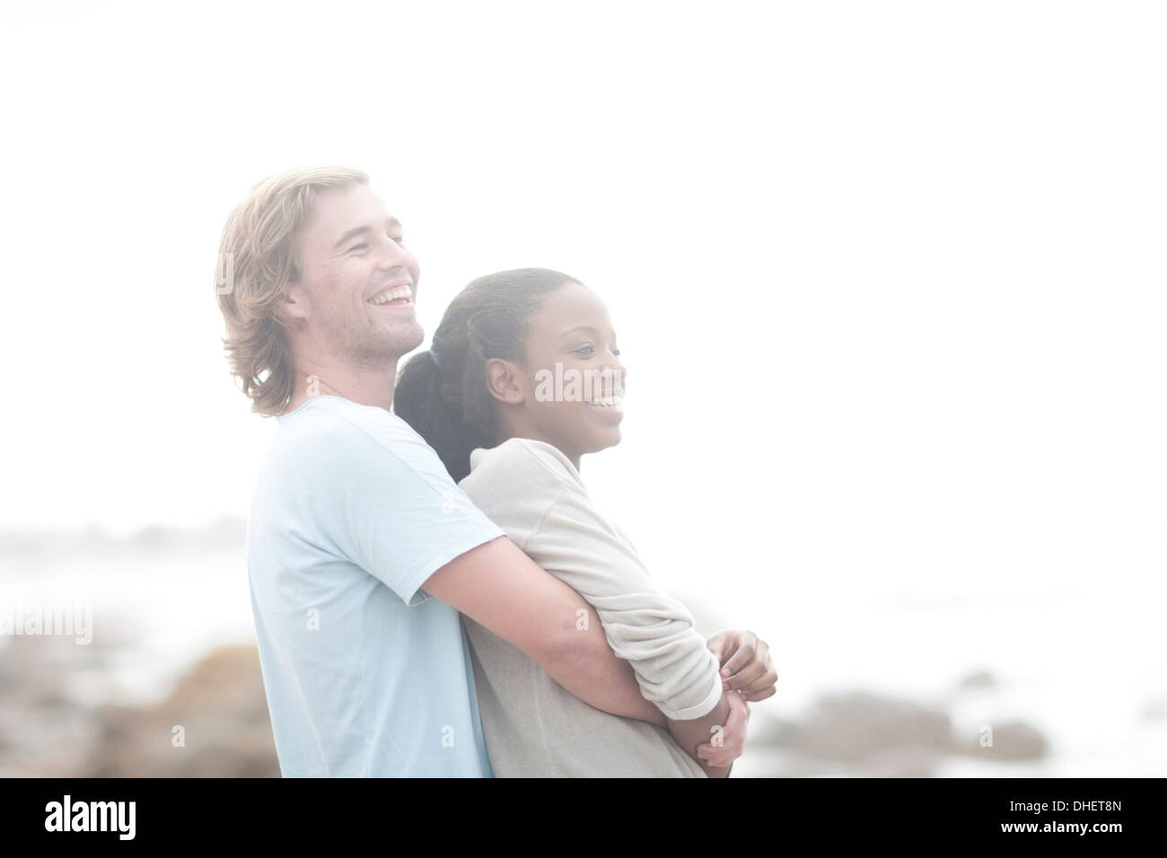 Couple hugging on beach Photo Stock