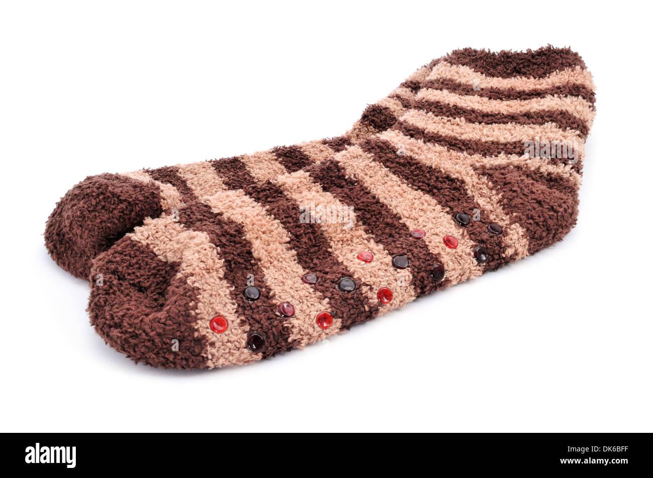 Une paire de chaussettes antidérapantes rayé sur fond blanc Photo Stock