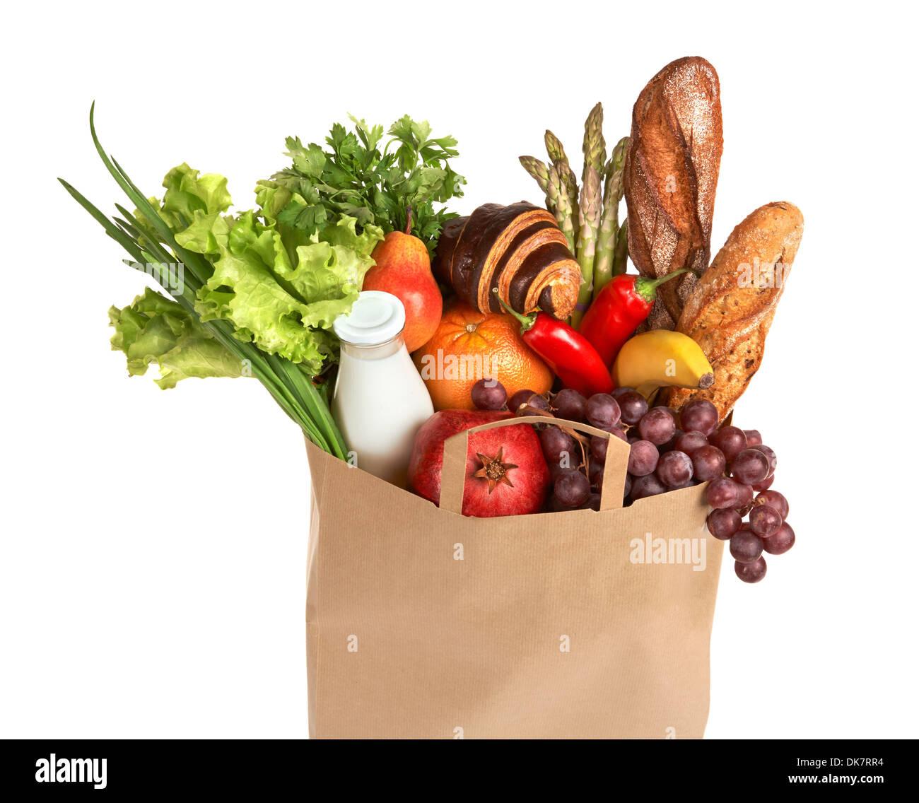 Un sac d'épicerie rempli de fruits et légumes sains Photo Stock
