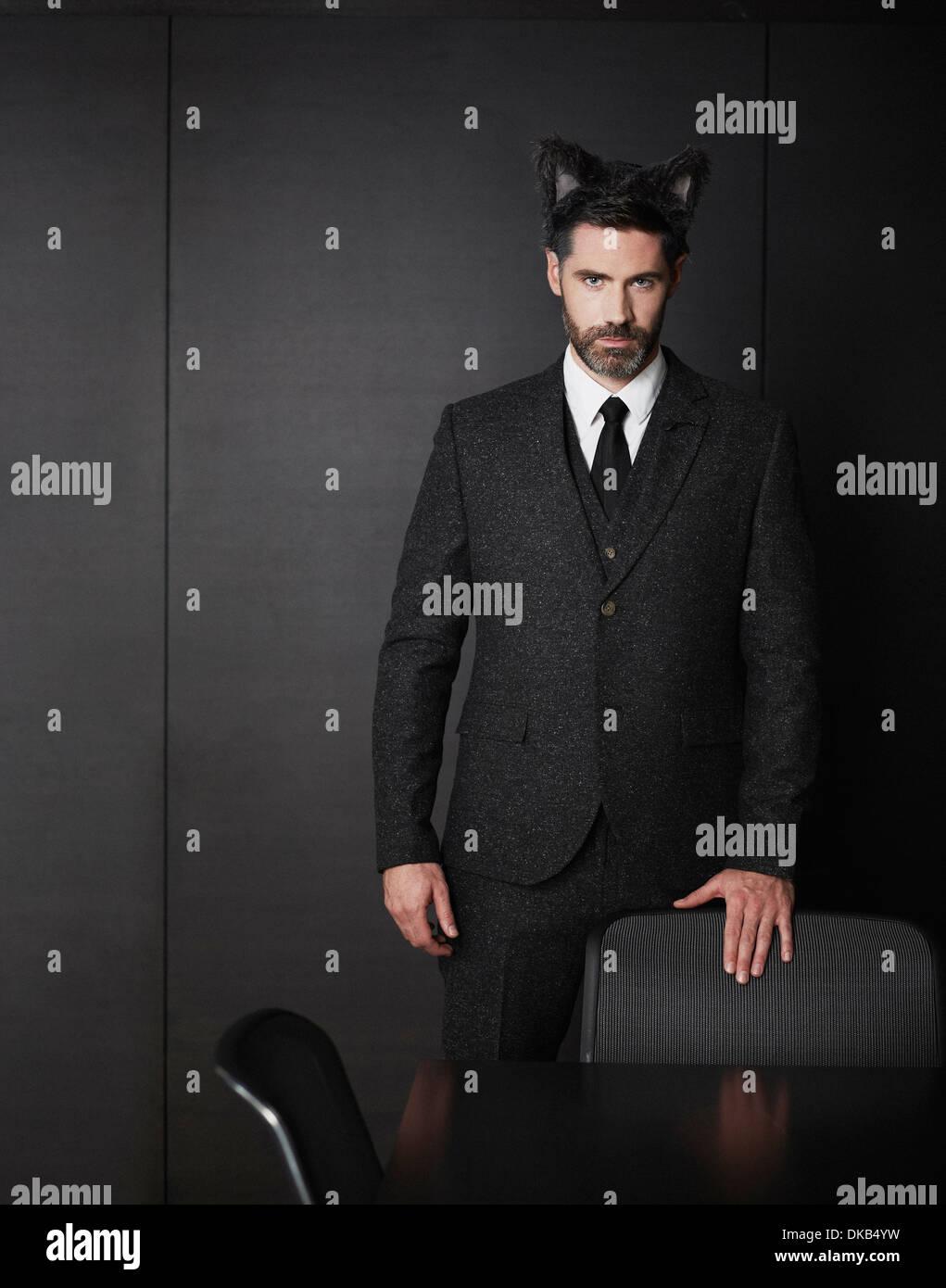 Businessman wearing fancy dress oreilles Photo Stock