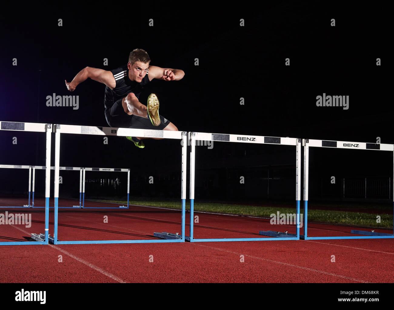 Athlète course de haies Photo Stock