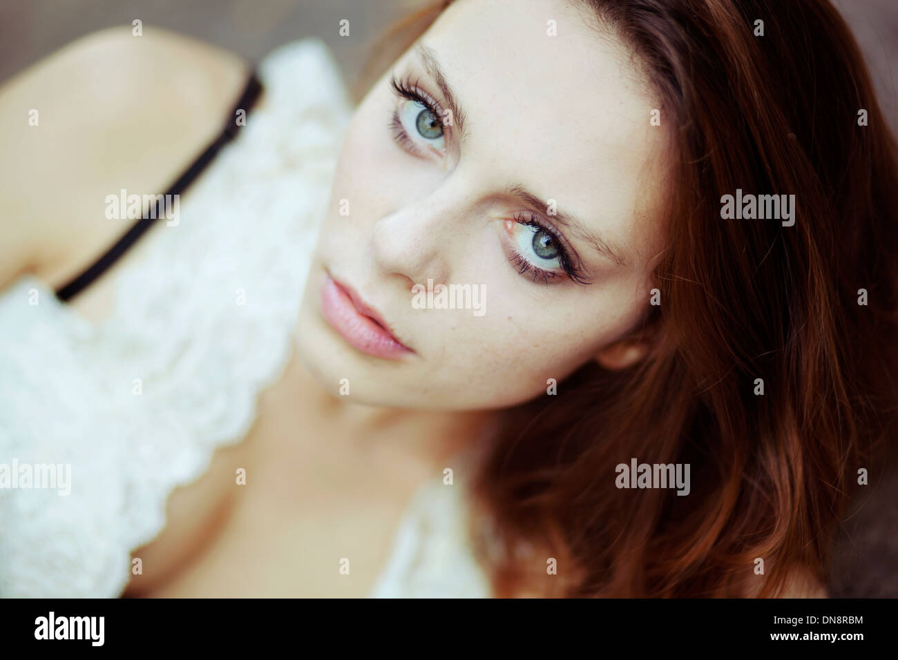 Portrait of young woman looking at camera Photo Stock