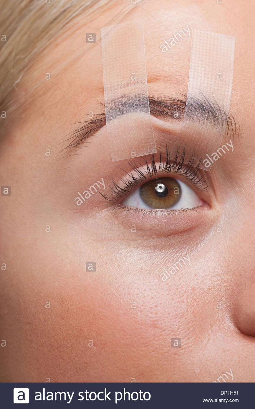 Close up of woman's eye open enregistrées Photo Stock