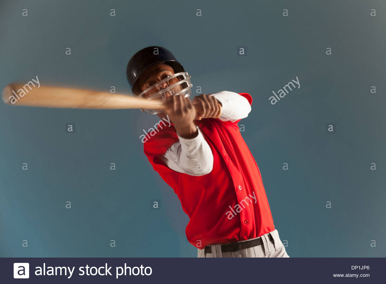 Blurred view of baseball player swinging bat Photo Stock