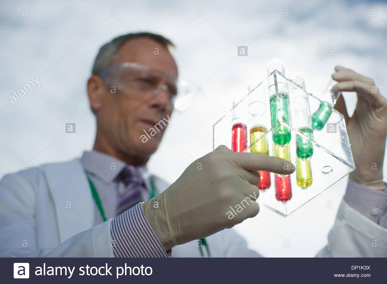 Scientist examining liquid in test tube Photo Stock