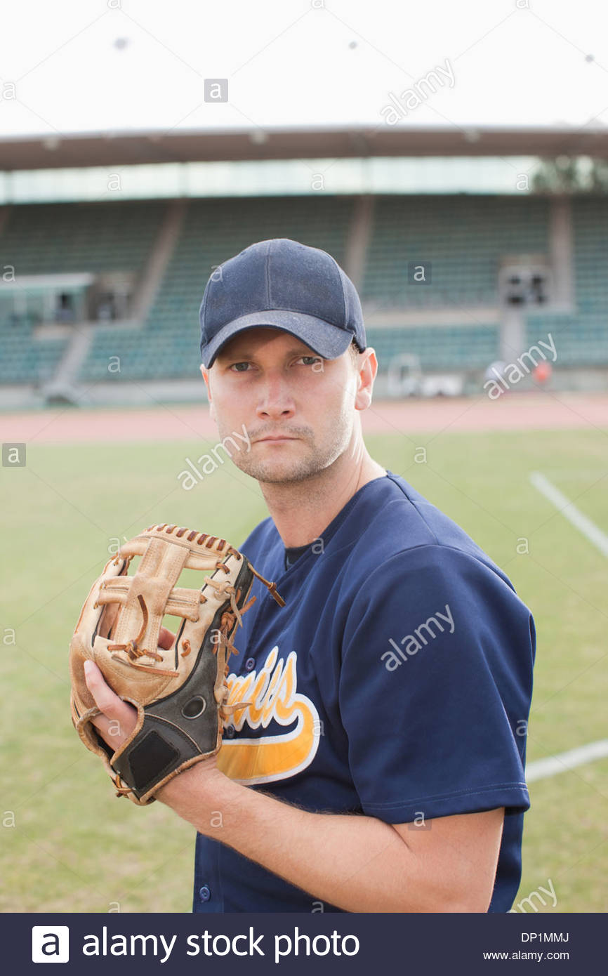 Baseball pitcher preparing to throw ball Photo Stock