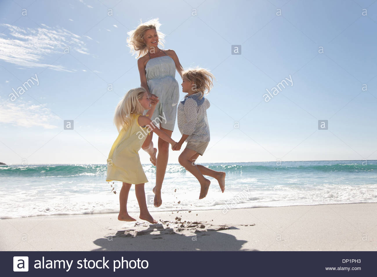 Family playing on beach Photo Stock