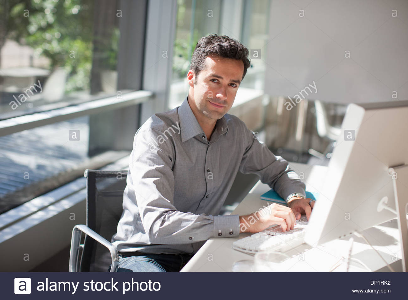 Businessman using computer in office Photo Stock