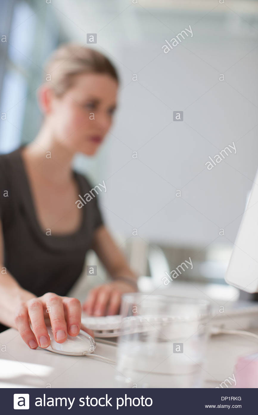 Businesswoman using computer in office Photo Stock