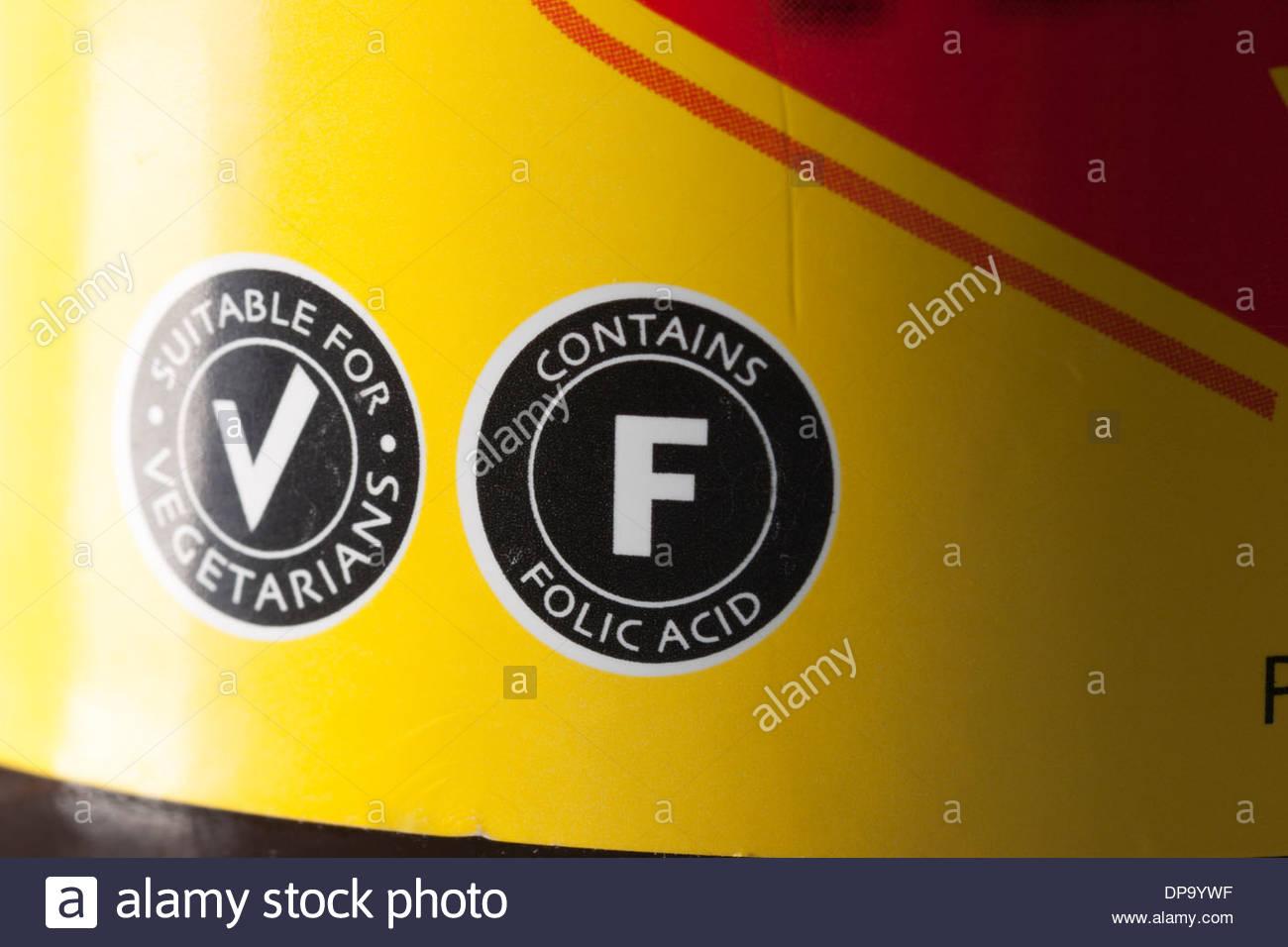 Étiquette indiquant la pertinence du produit alimentaire pour les végétariens, il contient de l'acide folique. Cette étiquette se trouve sur un pot de Vegemite. Photo Stock