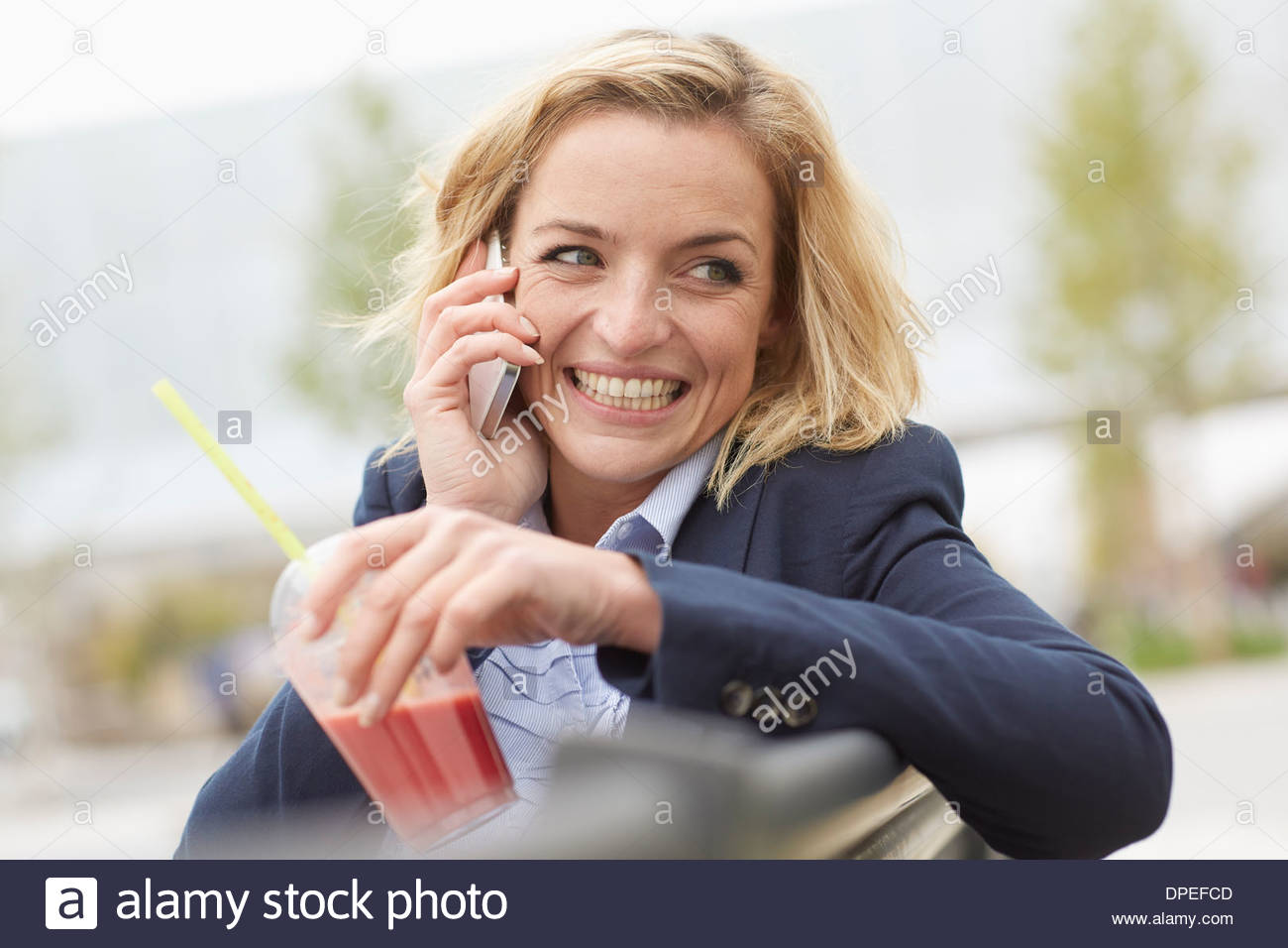 Office worker having lunch break on park bench Photo Stock