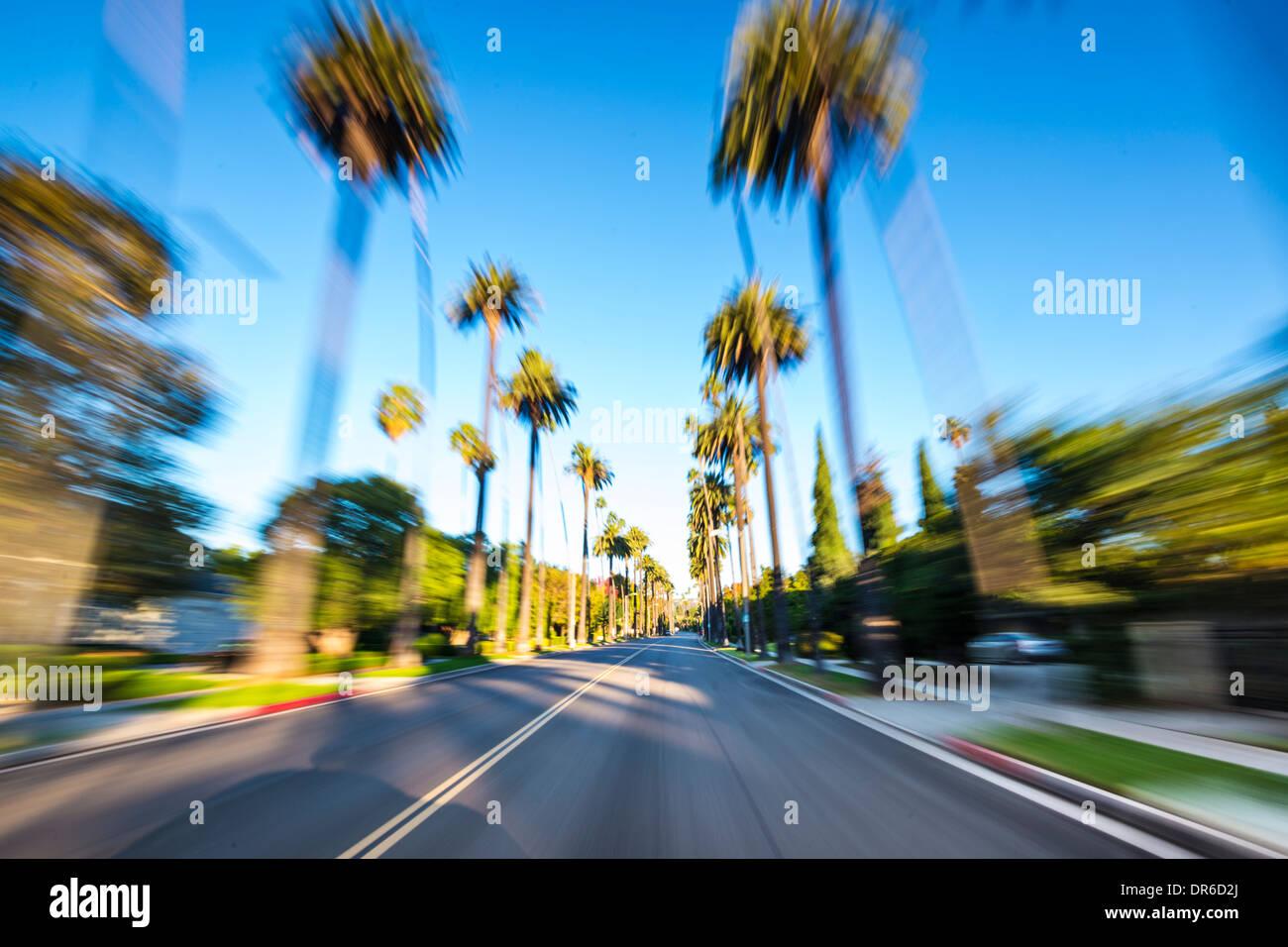 Beverly Hills drive par avec le flou. Photo Stock