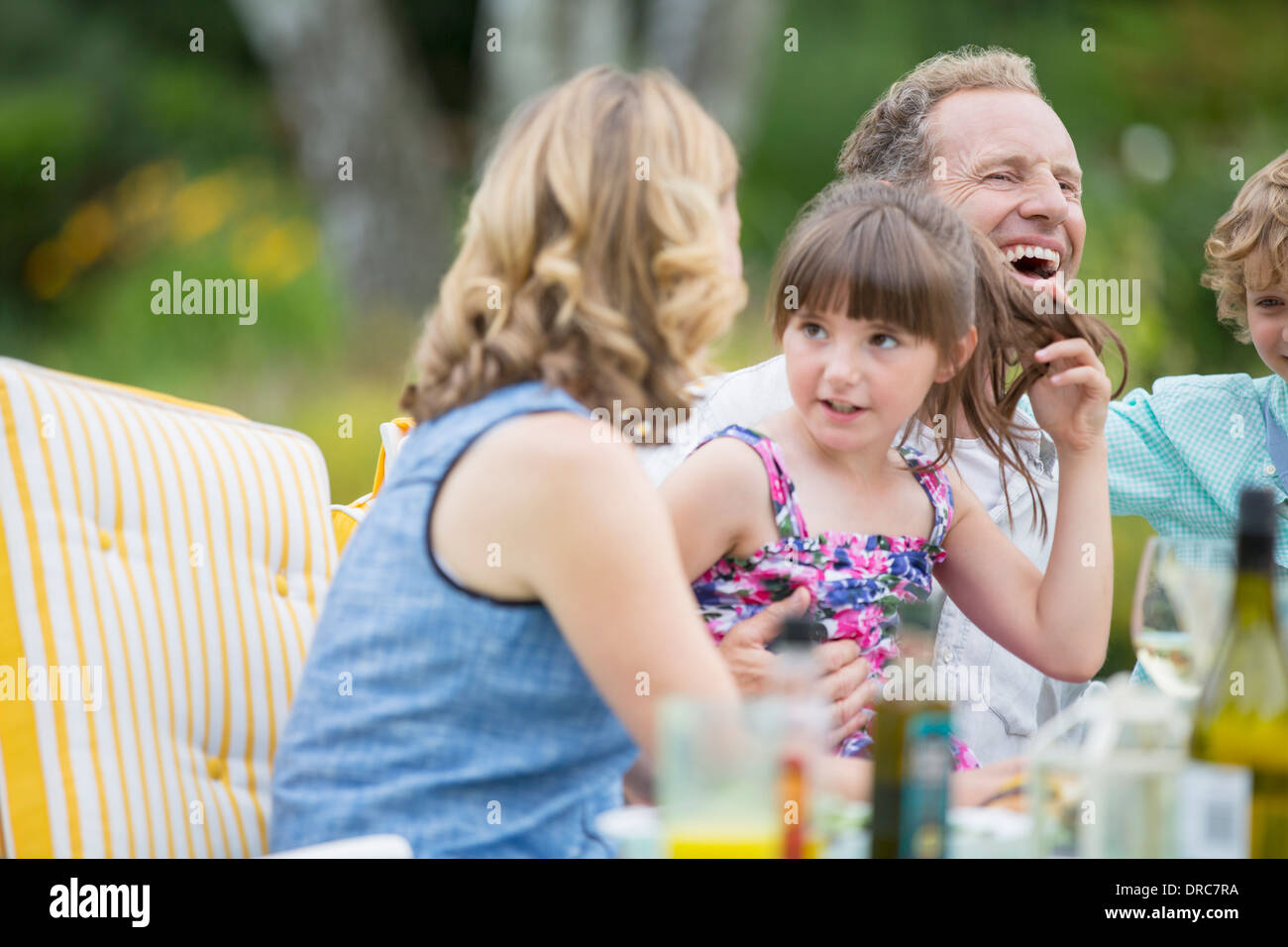 Family eating on patio Photo Stock
