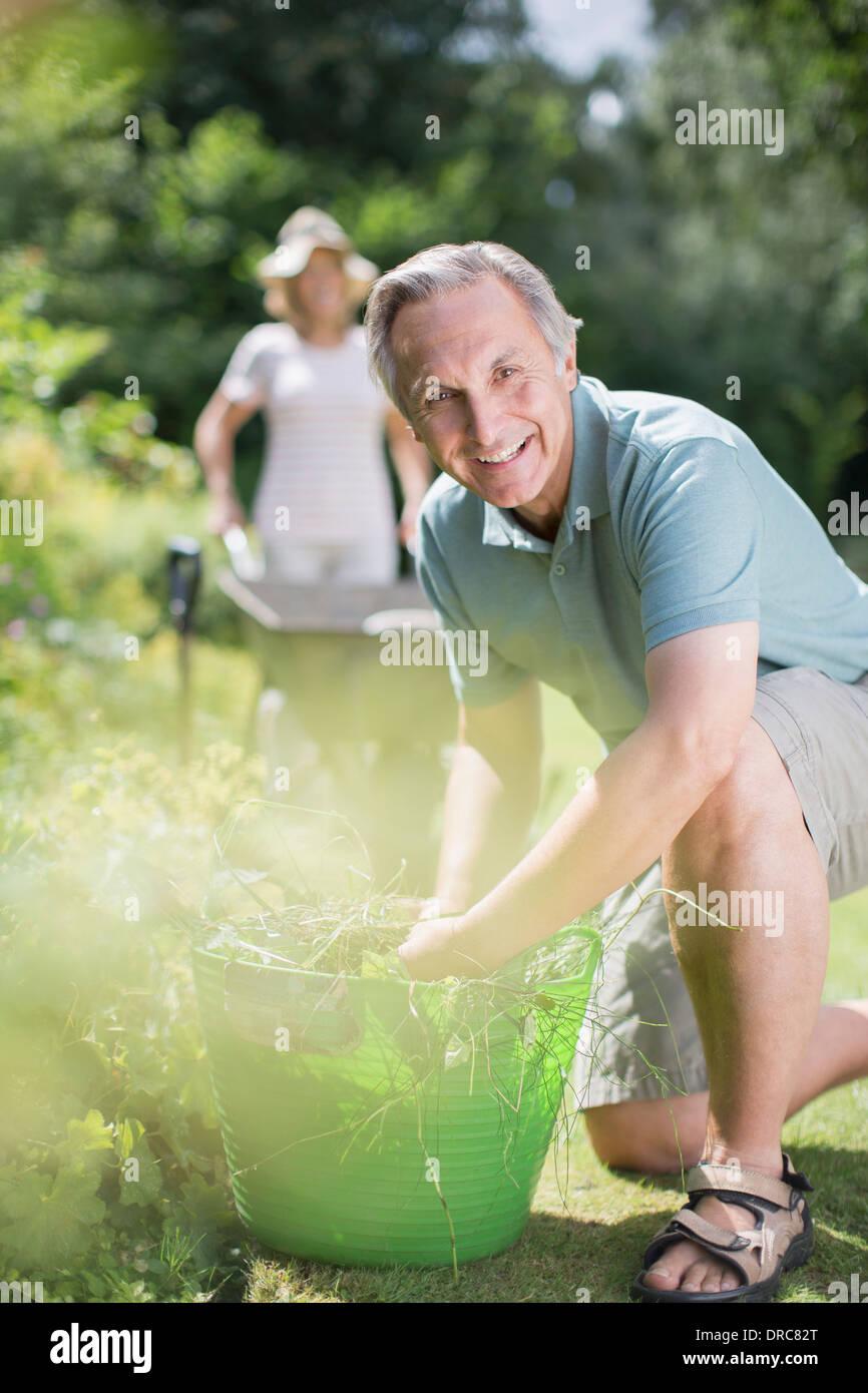 Senior couple working in garden Photo Stock