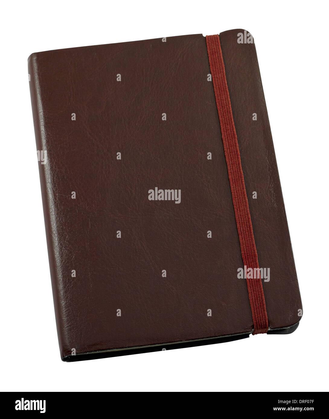 Un format de poche relié en cuir à un journal pour garder une trace écrite à la main de souvenirs Photo Stock
