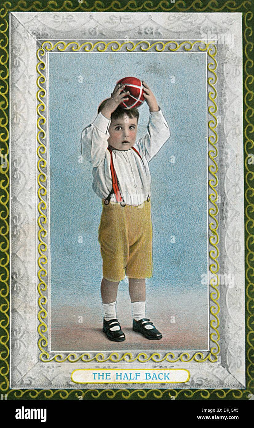 La moitié arrière - un jeune footballeur Photo Stock