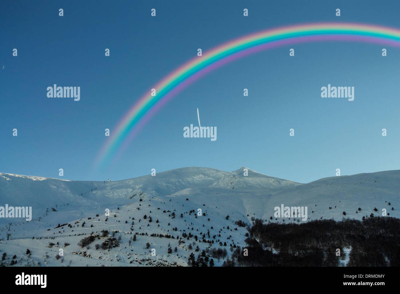 Arc-en-ciel dans les Snowy Mountains Banque D'Images