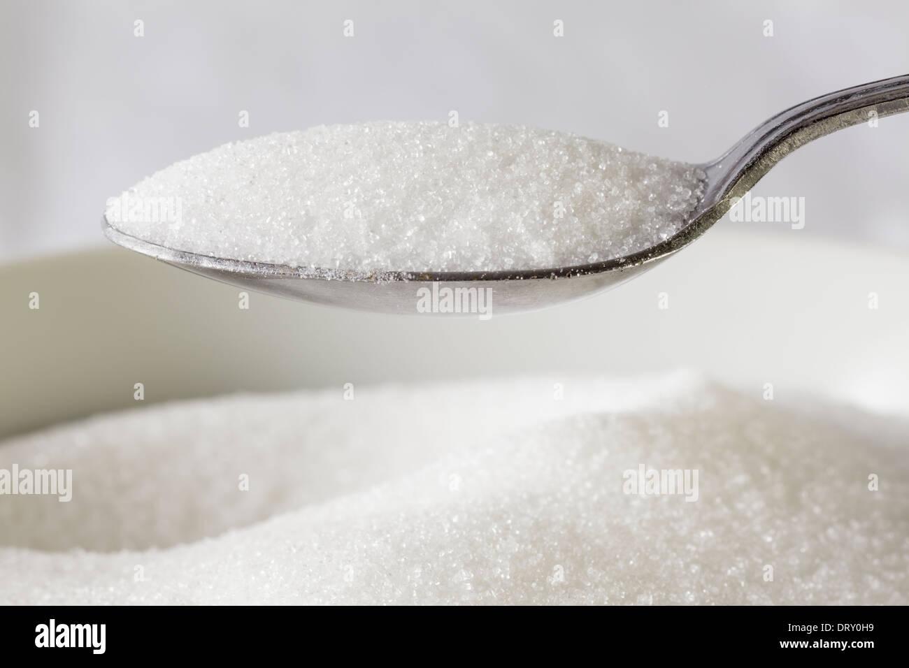Cuillère de sucre complet Photo Stock