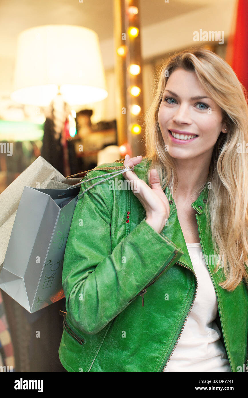 Woman carrying shopping bags over shoulder Photo Stock