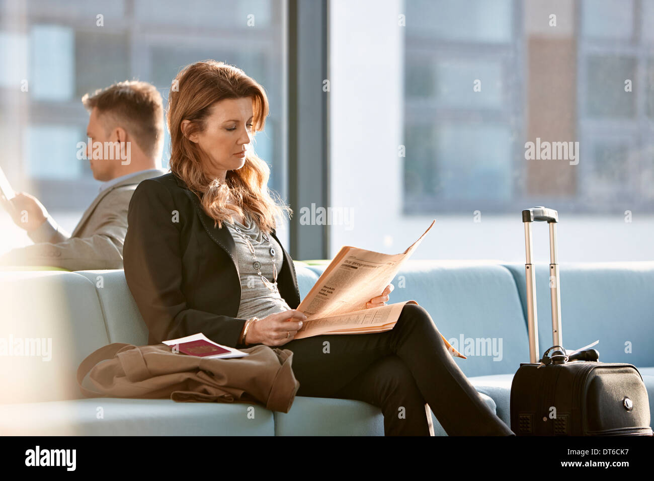 Businesswoman in departure lounge Photo Stock