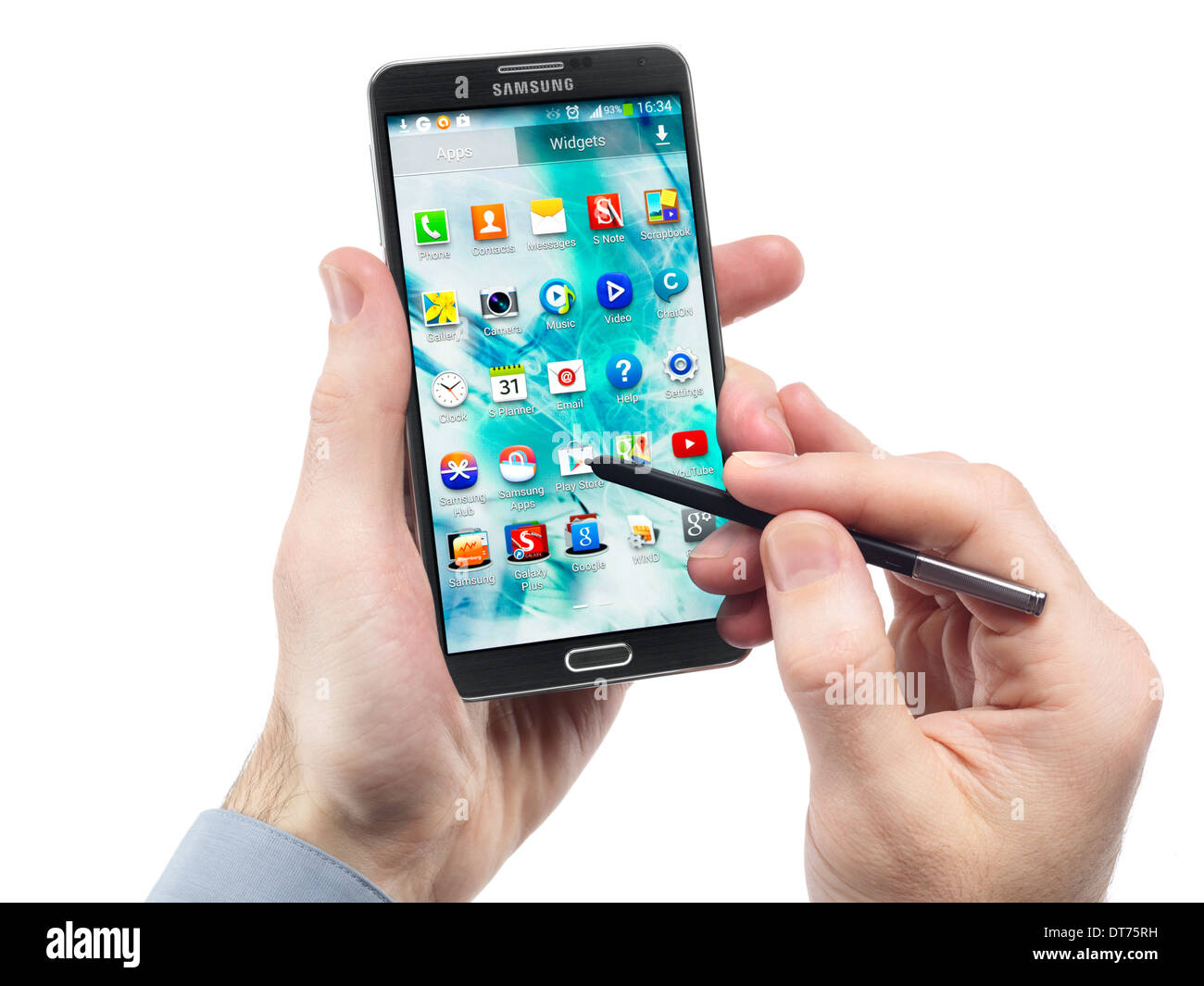 L'homme les mains avec smartphone Samsung Galaxy Note III isolé sur fond blanc Photo Stock