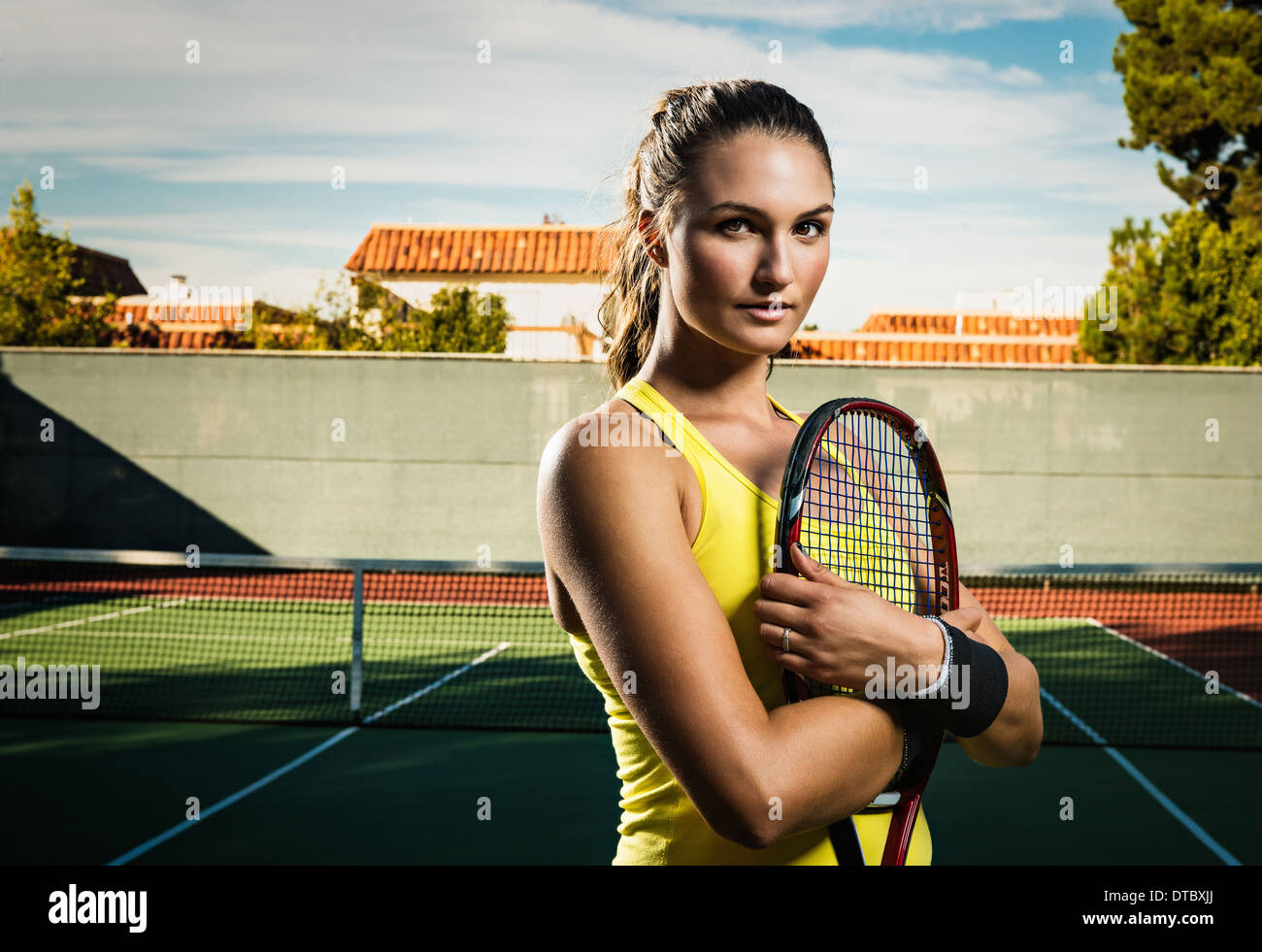 Tennis player holding racket Photo Stock